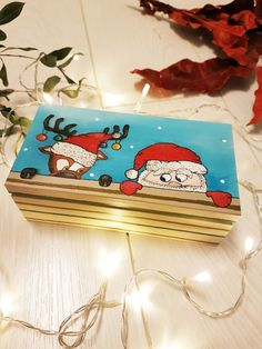 Christmas gift idea for kids. Hand painted wooden box could be a great Baby's first Christmas present. It is unique Christmas stocking stuffer idea for the kids. Perfect Holiday gift ideas from Santa.  Snowy Winter night Santa Claus and Reindeer Wooden Trinket Box. Handmade Christmas Gift Box  #christmas #box #reindeer #santa #santaclaus #merrychristmas #christmasgifts