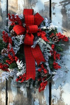 Simple and pretty....dusty miller, red berries and plaid ribbon wreath