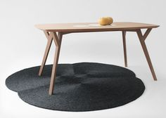 Martin Azua's Trees and Rocks table contrasts wood with marble http://www.martinazua.com