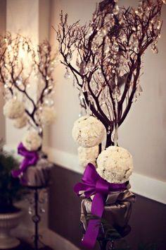 Beautiful wedding tree decorated with purple ribbon.