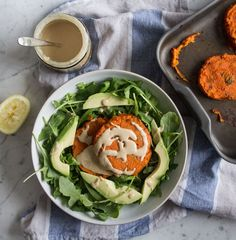 Sweet potato cakes with tahini, garlic and coriander - one of my favourite dinners, served with avocado and a fresh salad. An easy vegan, gf idea!