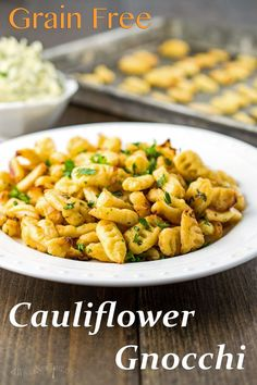 Homemade Grain Free Cauliflower Gnocchi with Parmesan, is crispy on the outside and light and fluffy on the inside. Enjoy this gluten free Italian classic, without all the starch!