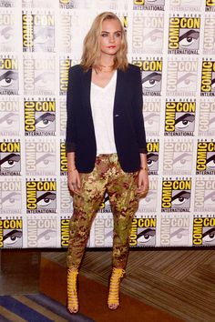 Cara Delevingne - Promoting her new film Valerian and the City of a Thousand Planets, Cara looked cool in DSquared2 Resort 2017 camo sequin pants and two-tone lace-up booties. Shop similar pants here.