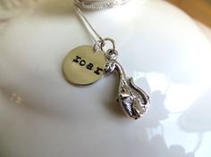 "Dinosaur necklace with sterling silver hand stamped ""roar"" charm and adorable dinosaur charm. $31.00 on Etsy. #etsy"
