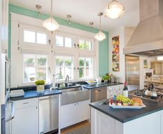Seafoam green wall gives this space so much life!