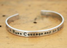 Have Courage and Be Kind hand stamped cuff bracelet. From the movie Cinderella by JustJaynes on Etsy https://www.etsy.com/listing/214195876/have-courage-and-be-kind-hand-stamped