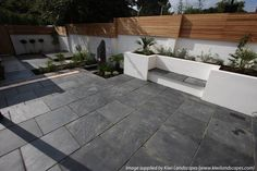 Gray offset patio pavers and cedar color fence - love