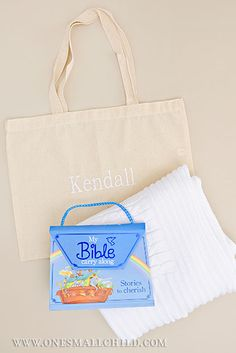 In search of personalized baby gifts? Check out our book and blanket gift totes! They make for a fun personalized gift for babies and toddlers! Christening Gowns For Boys, Baby Christening Outfit, Christening Gifts, My Bible, Bible Book, Baby Gift Sets, Personalized Baby Gifts, Knitted Blankets, Reusable Tote Bags