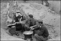 March Three Republican soldiers cooking over fire in the sand in an internment camp for Spanish refugees. (From the Mexican Suitcase)//Robert Capa Nerja Spain, Cooking Over Fire, Guernica, Magnum Photos, Civilization, Old Photos, Spanish, 1, Ian Gibson