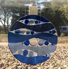 Colors of the ocean are showcased in this cobalt blue and medium blue abstract window panel. The first process was to make the bubbles in the different sizes and colors. I fired the small pieces in my glass kiln to 1400 degrees. Next, onto clear glass, I put the cut waves onto it with