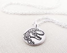 Tiny T Rex necklace, silver dinosaur necklace, Tyrannosaurus Rex jewelry by lulubugjewelry on Etsy https://www.etsy.com/listing/96800348/tiny-t-rex-necklace-silver-dinosaur