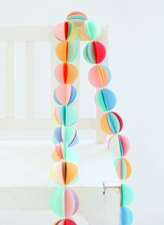 Super easy DIY garland if you have a circular punch (preferably one of those super duper large ones). Simply bunch 6-7 colourful circles together and sew in the middle. Fold out and voila.