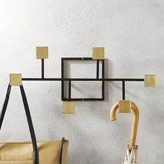 $50 BUY NOWWhen your coat rack looks this cool, your jackets, hats, and bags are more likely to end up hanging here than off of the kitchen counter stools. The modern, design-forward shape of this iron frame melds fun with function.