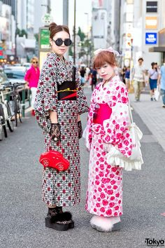 Mei – a 20 year old student, on the left – is wearing a black and red yukata from the Harajuku resale shop Chicago with furry platform sandals from Spinns Harajuku. Accessories – which are handmade and from flea markets – include round sunglasses, black lace gloves, lace socks, a jeweled ring, a traditional fan, and a bright red car handbag from Retro Girl.