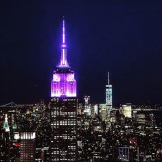 Empire state building lit purple in honor of Prince