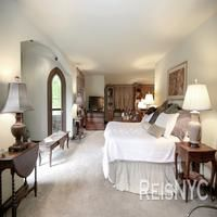 The particulars: Interior space: 5,764 square feet, 6 bedrooms. First floor great room, dining room with fireplace and music conservatory all with cherry and mahogany flooring and hand sculpted wood reliefs. The music conservatory hosts the great stone hearth, the essential core of the architectural style, accented by carved stone columns and sculpted stone reliefs.