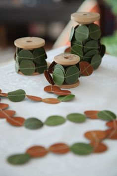 garland made from circles punched from magnolia leaves//hunt, gather and host: a christmas brunch | Design*Sponge