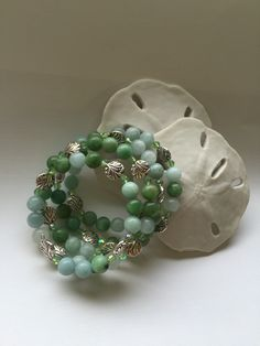A personal favorite from my Etsy shop https://www.etsy.com/listing/236140815/green-wrap-beaded-bracelet-silver