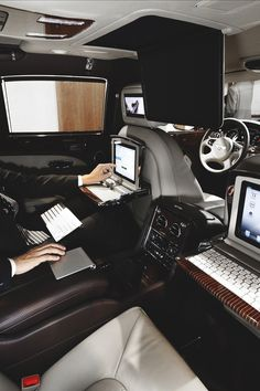 I don't know why I laughed so hard when I saw this.... Like a depiction for what it might encompass if one were to control the world from the backseat of their car... Is this really power/control or the illusion of?... Guess it's just not my ideal of luxury... Ok, I've stepped off the soapbox...
