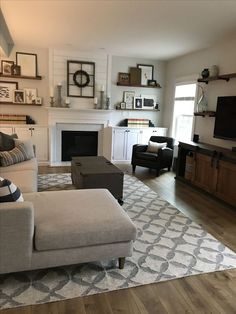 Modern Farmhouse living room - Interior Define Sofa, West Elm Kilim Tile Rug, Sherwin Williams Frosty White, Shiplap, Floating shelves around fireplace