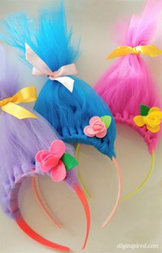 Make this cute Troll hair headbands out of tulle and felt flowers. Fun and easy DIY to do with your kids they will absolutely love it! Great idea for Halloween