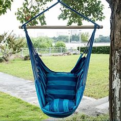 Enjoy the great outdoors! Relax away those warm summer days on this cozy hammock chair. It comes with two soft cushions and fits kids and adults. <br> <ul><li> Hammock chair can be used indoors or outdoors </li> <li> Crafted from real wood and cotton/polyester fabric blends </li> <li> Holds up to 250 lbs. </li> </ul>