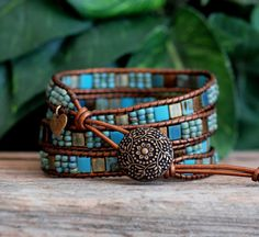 **NEW IN THE SHOP!** This four wrap bracelet features 5x5mm Miyuki Tila Beads, in gorgeous shades of bronze and turquoise, meticulously