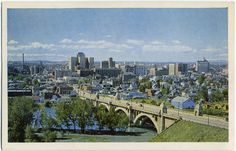 Bird's eye view of Calgary looking south. Centre street bridge is visible in the foreground. Robin Hood Flour mill can be seen on the right hand side and the Palliser Hotel on the left hand side.  Date of postcard unknown.