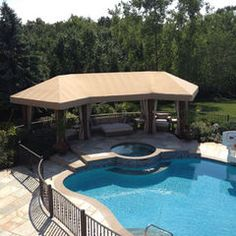 Durasol Pergola cover and stationary panels using Sunbrella Fabric by Window Works