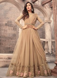 Beige Embroidered Net Anarkali Suit features a beautiful net top alongside a santoon bottom and inner. A chiffon dupatta completes the look. Embroidery work is completed with zari, thread, and stone.