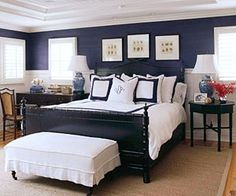 Navy bedroom walls, white trim.  i love the one with the pink night table from this blog post
