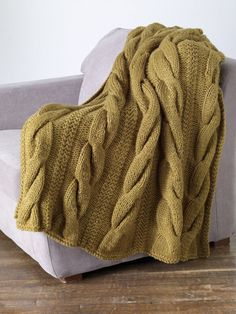 Classic Cable Throw in Lion Brand Wool-Ease Thick & Quick - 80882AD. Discover more Patterns by Lion Brand at LoveKnitting. The world's largest range of knitting supplies - we stock patterns, yarn, needles and books from all of your favorite brands.