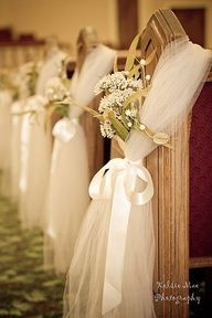 Easy and inexpensive aisle decor: tulle, ribbons, and flowers.Some variation on this might work. I think the tulle adds a lot of bulk so it looks really decorated and it would be inexpensive. You would obviously substitute the flowers. But the tulle makes a nice holder to sit a small bouquet of flowers in.