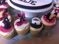 handbag and shoes on to of yummy vanilla cupcakes all hand crafted by cakes for takes
