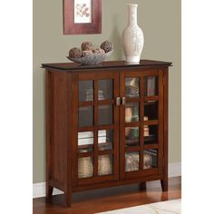 The Stratford Medium Storage Media Cabinet & Buffet makes a wonderful addition to any dining room or living room furniture arrangement. Store your fine china, movies or favorite decor pieces in the cabinet while displaying family photos on the wide top.