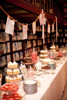 These library shelves make an amazing backdrop for the sweets table.