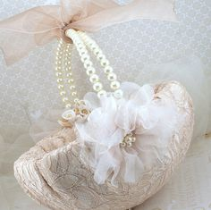 basket with lace, pearls, sheer bows and flowers...