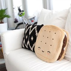 An adorable s'mores pillow warmer to toast your lap and your heart.