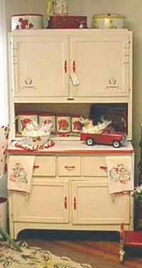 Hoosier Cabinet--Complete with an enamel pull-out work surface, they also boasted a tin lined bread drawer, additional drawers for utensils, and shelves behind the doors for more storage. Most had a roll-down tambour door tucked just below the top doors to hide away clutter.