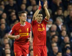 Luis Suarez applauds the travelling Liverpool supporters