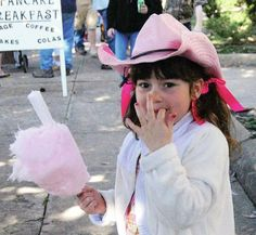 Staff photo by Susan W. Thurman Pink on pink Bella Strahan, 6, enjoys her pink cotton candy Saturday. Staff photo by Susan W. ThurmanRoyal waitAvery Mallory, 2, with her crown bedecked, mule-eared hat, waits for the Mule Day Parade to start Saturday in downtown Columbia.