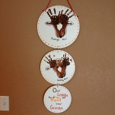 """Kids feet & handprints make a deer. Great gift for grandpa or dad who hunt. """"our grandpa (or dad) can out hunt your grandpa (or dad)."""""""