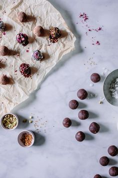 Simple + Easy Raw Vegan Adaptogen Coconut Cacao Bliss Balls recipe with Reishi & He Shou Wu. These healthy, protein and superfood packed energy bites are made with dates, almonds, raw chocolate powder, and healing herbs making them the perfect dairy-free, gluten-free, paleo, and Whole 30 friendly snack! Even kids love them!