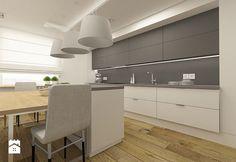 Nowoczesna kuchnia w apartamencie w Tomaszowie Mazowieckim - zdjęcie od design…