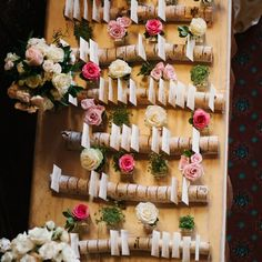 Love the idea of putting escort cards in birch logs with some flowers/greenery around