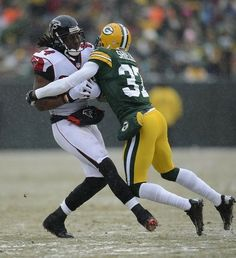 Green Bay Packers cornerback Sam Shields tackles Falcons Roddy White at  Lambeau Field. 38411c608