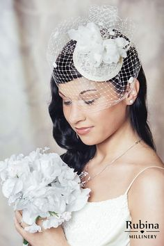 eeb28097cdcc7 Cream bridal fascinator with sheer silk flowers and birdcage veil with  spots by RUBINAMillinery  bridal