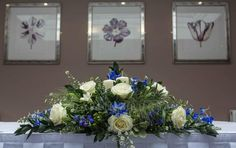 Long and low design in blues and whites - Darling buds florist