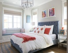 Teen Bedroom. Fun teen's bedroom with tufted headboard and window seat. Lighting is from Crystorama. #Teenbedroomdecor Patterson Custom Homes. Interiors by Trish Steele, Churchill Design.