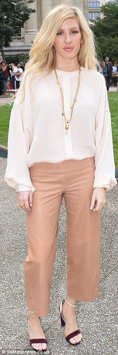 Glamorous: Both Rosie and Ellie Goulding donned similar styles, tucking a white shirt into coloured trousers and wearing heeled sandals when they attended the Chloe show for Paris Fashion Week